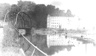 Warren Factory iron bridge 1922-1923: This bridge was built in place of the covered bridge that was destroyed in an 1895 flood. This image is part of the collection of historic photographs of Baltimore County, Maryland USA owned by the Baltimore County Public Library, Towson Maryland USA.