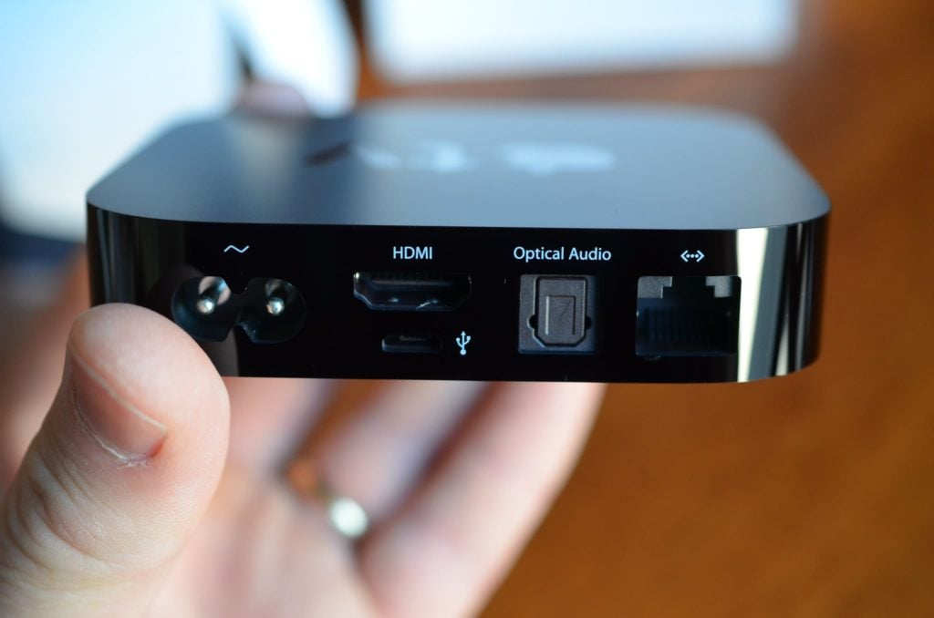 Image of hand holding a 2nd generation apple tv