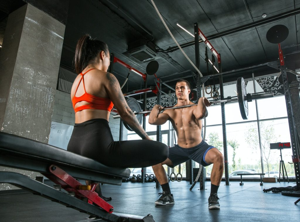 A muscular athletes doing workout at the gym