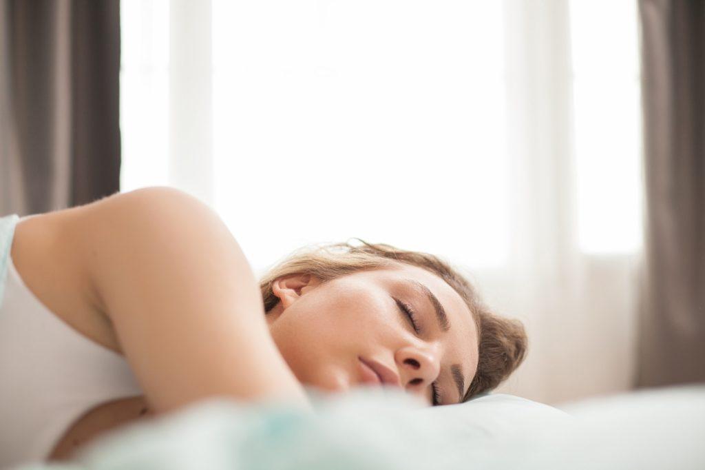 Adorable beautiful woman in pajamas sleeping