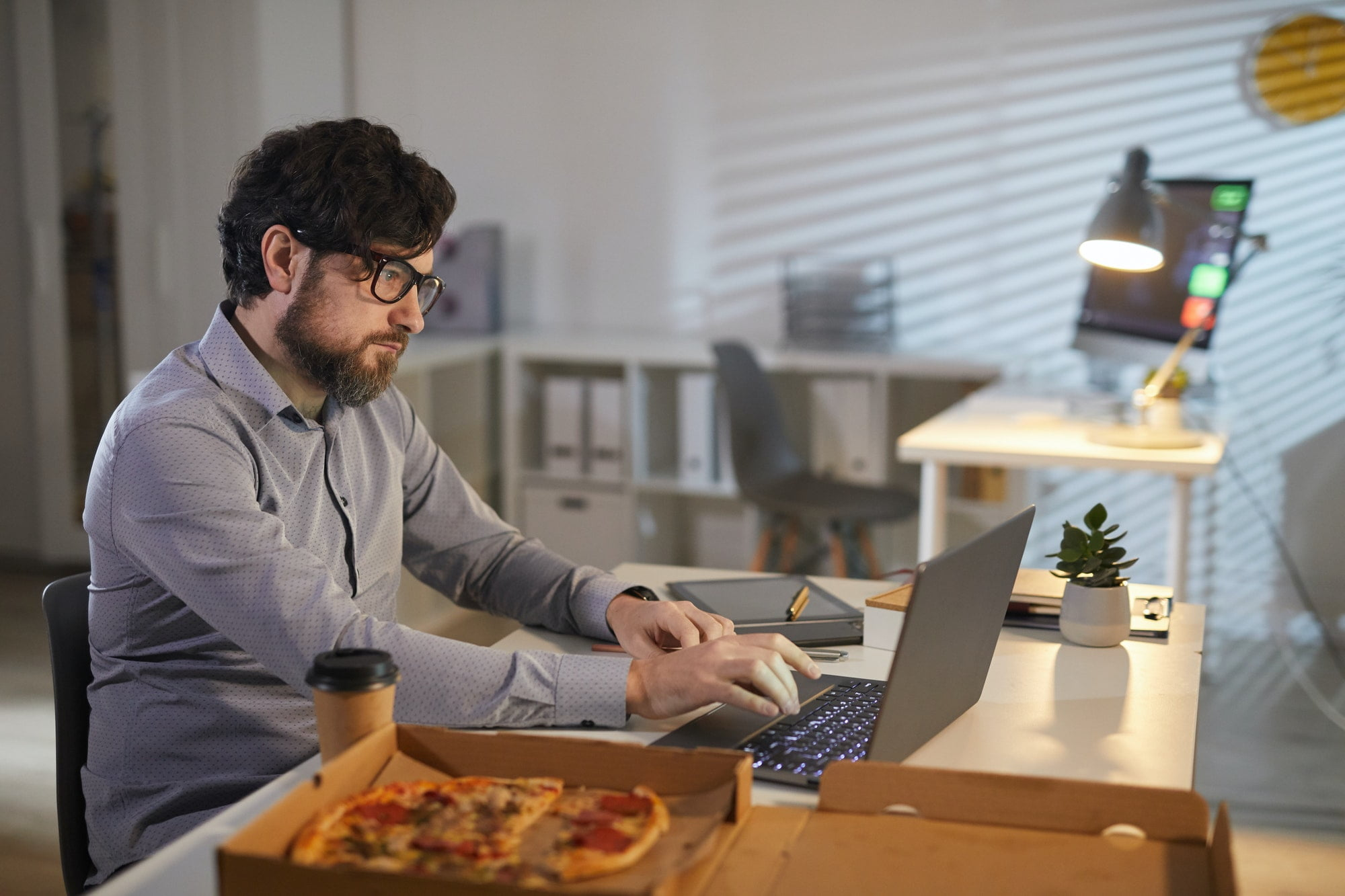 Businessman working and eating at office