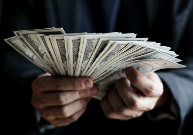 Closeup of hands holding cash