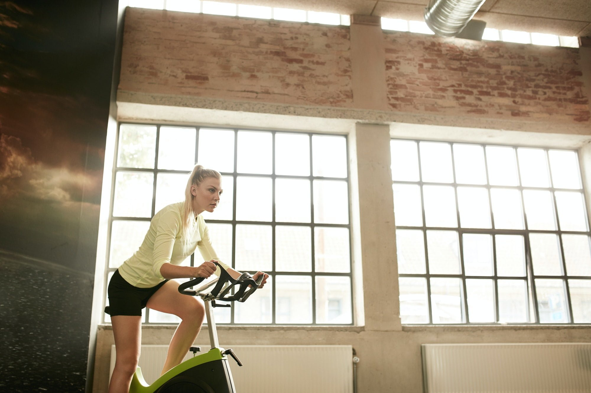 Female exercising on a spinning cycle