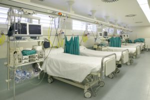 Hospital intensive care unit area with beds equipment. Health center