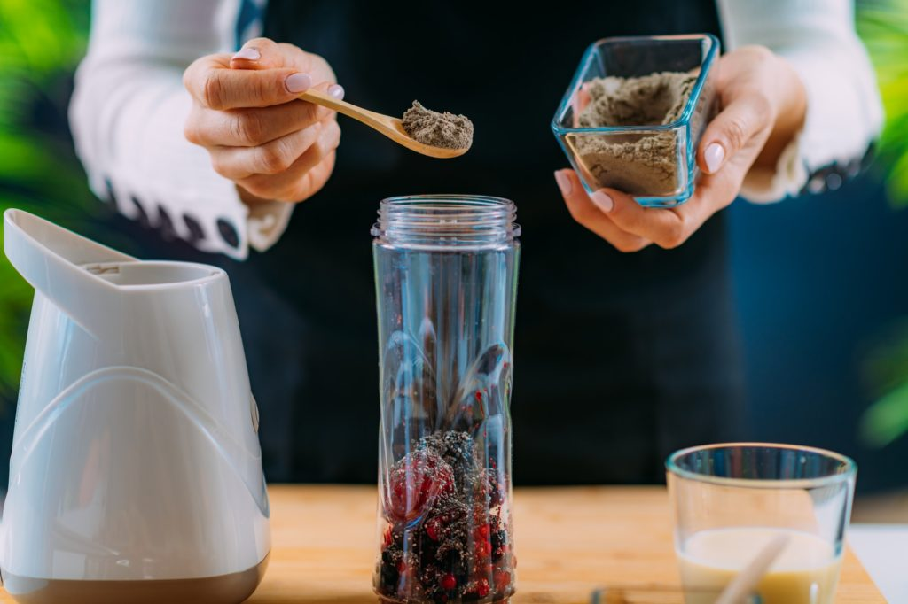 Making Healthy Shake with Berries and Plant Protein Powder