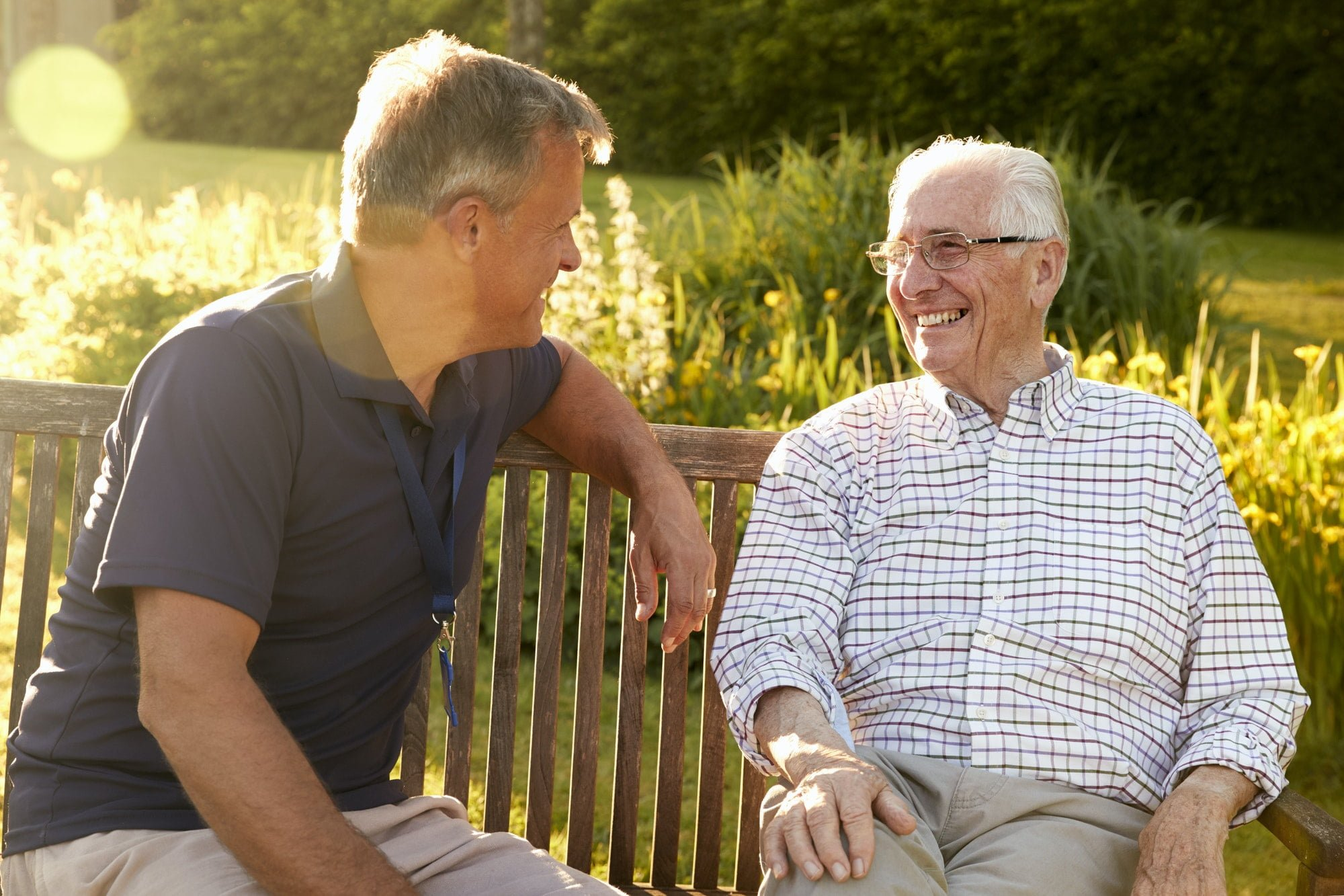 Man Visiting Senior Male Relative In Assisted Living Facility