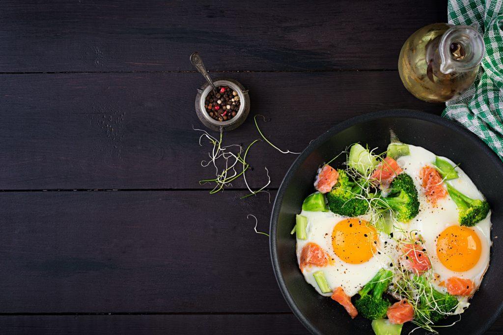Ketogenic/paleo diet. Fried eggs, salmon, broccoli and microgreen.