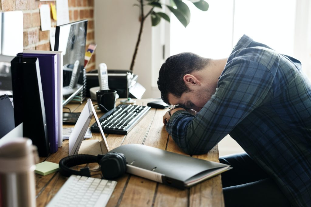 Tired man napping on the working desk