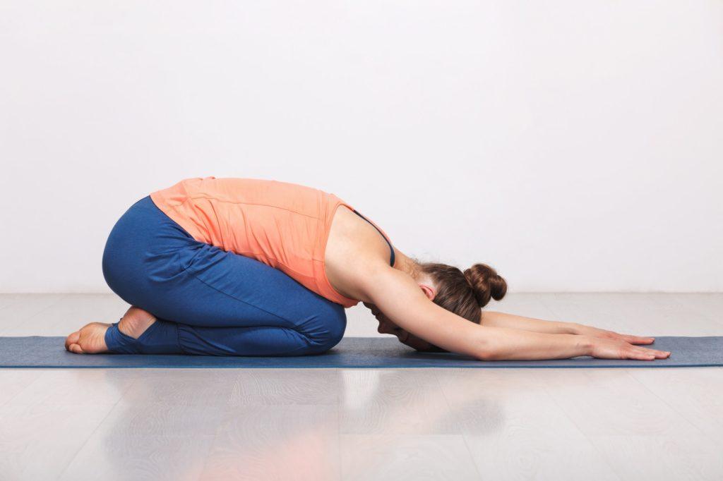 Woman relax in Hatha yoga asana Balasana child pose