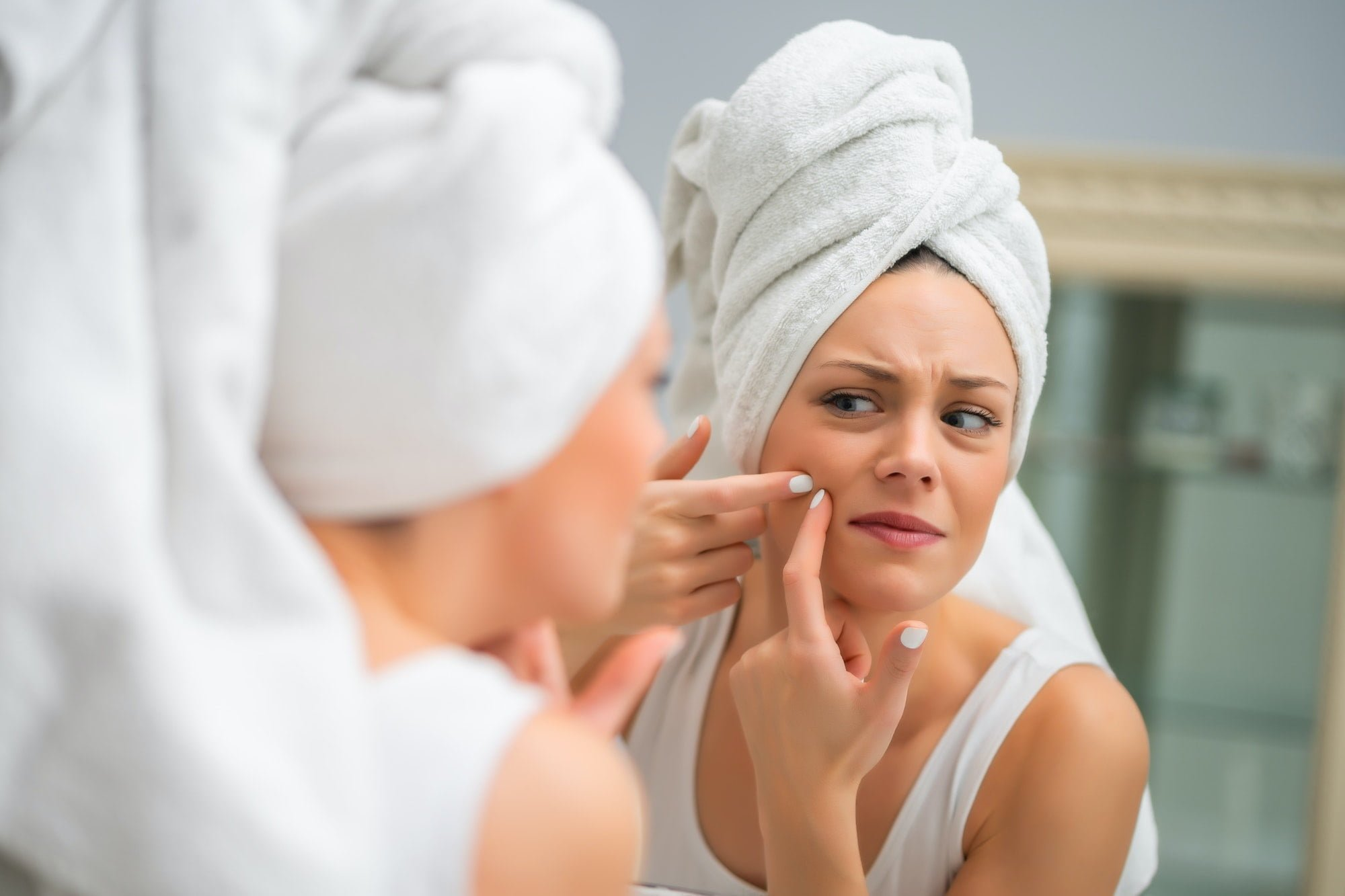 Woman squeezing pimple