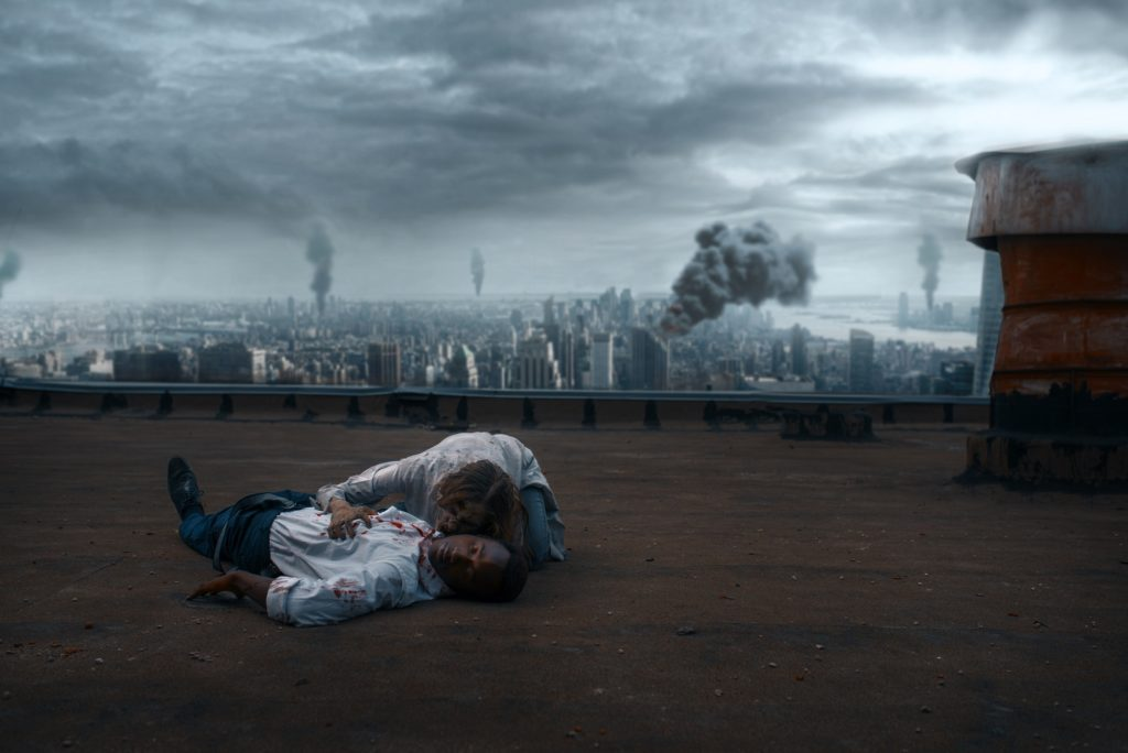 Zombie couple on the roof of abandoned building