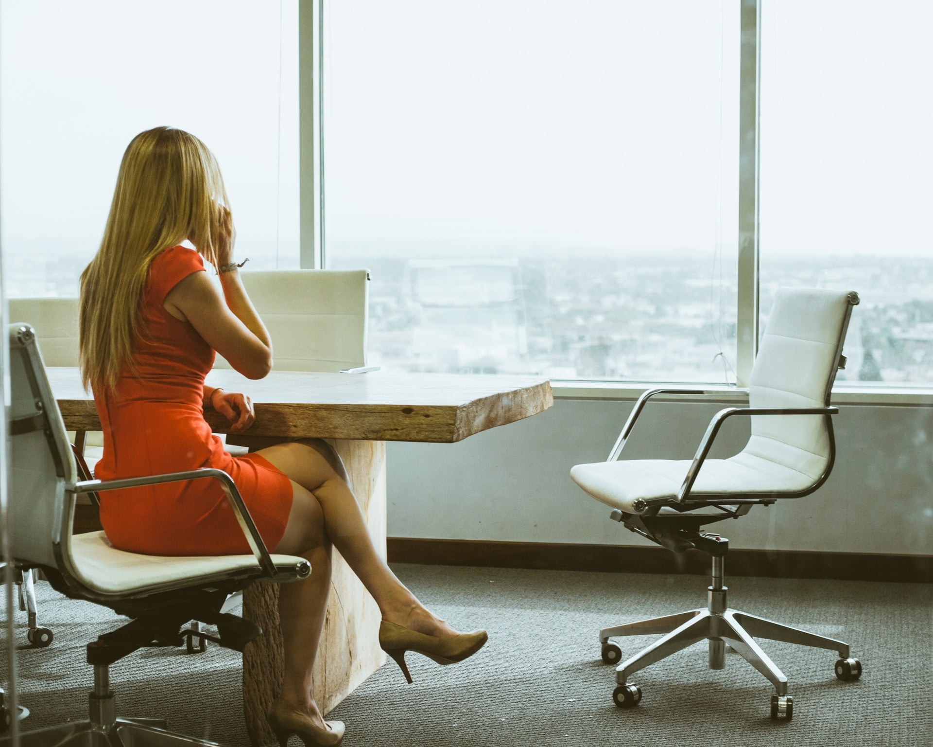 woman in red dress in office