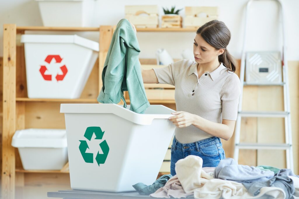 Woman recycling her wardrobe to declutter her home