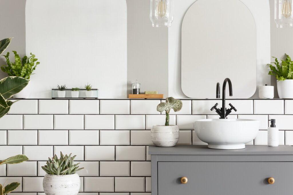 Real photo of a washbasin on a cupboard in a bathroom interior w