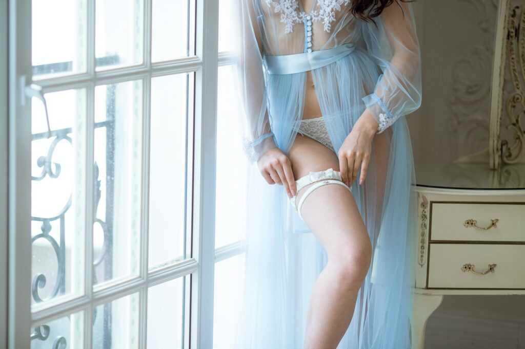 Beautiful sexy lady in elegant blue robe and garter